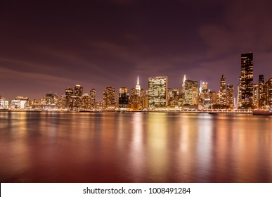 Long exposure of the Manhattan skyline taken at night from Gantry Park Queens. I used a warmer setting for this shot