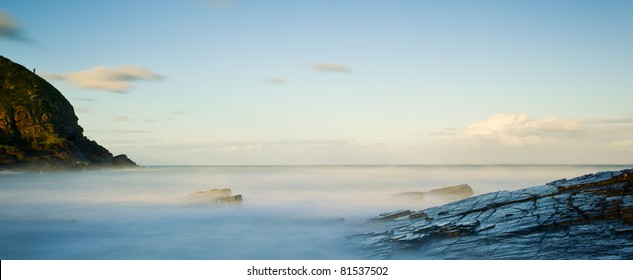 long exposure of misty sea and rocks