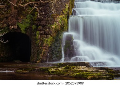 Long exposure of the Monsal Dale Weir waterfall and River Wye on the Monsal Trail in the Peak District - Shutterstock ID 2052593909