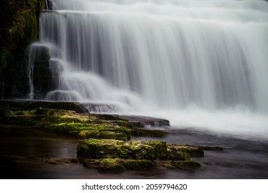 Long exposure of the Monsal Dale Weir waterfall and River Wye on the Monsal Trail in the Peak District - Shutterstock ID 2059794620