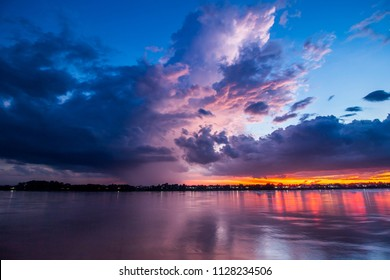 Long exposure to Motion blur Storm clouds before the rain and colorful purple sky at before storm in evening have reflection of Mekong River Nong Khai Province Thailand.Landscape Nature HDR Tone.