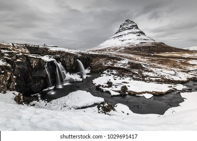 Long exposure of  mountain with waterfall  foreground in winter, Iceland