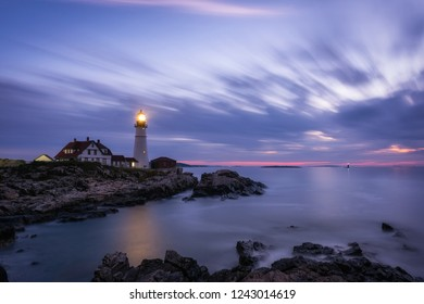 Long exposure of moving clouds over Portland Head Lighthouse in Cape Elizabeth, Maine.