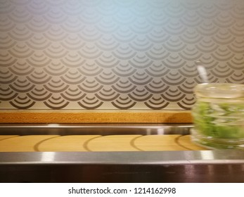 Long exposure of moving sushi plate and wasabi. Blurry motion effect. Out of focused on subject.