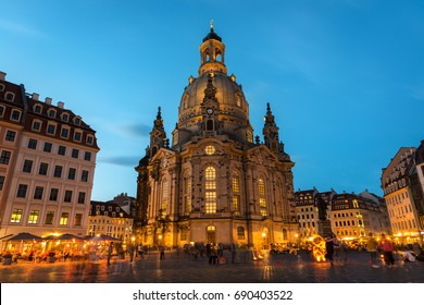 Long exposure of the Neumarkt square and Frauenkirche (Church of Our Lady) in Dresden on a clear Summer night, with the square full of unrecognizable tourists and locals.