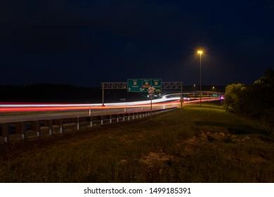 Long exposure night photo of James Rive highway 60 and highway 65 Interchange in Springfield Missouri.