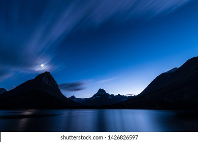 Long exposure night photograph of Swiftcurrent Lake in Glacier National Park, Montana.