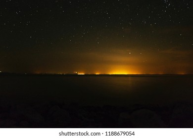 A long exposure night shot from Samothrace, in which we can see the lights of Alexandroupolis.