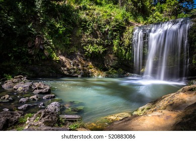Long Exposure of Oakley Creek Waterfall on a bright Summers Day, Auckland, New Zealand - Side View