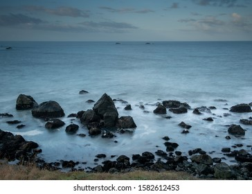 Long exposure of the Ocean from Rocky point, Patricks Point State Park, Northern California, USA, long exposure, featuring predominantly blue colors and a cloudless day, with lots of copy space