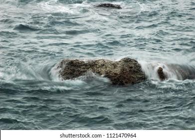 Long exposure of ocean water run over rock, Taipei, Taiwan.