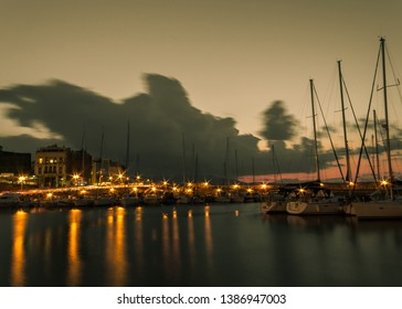 long exposure old harbor view boats sky car lights water