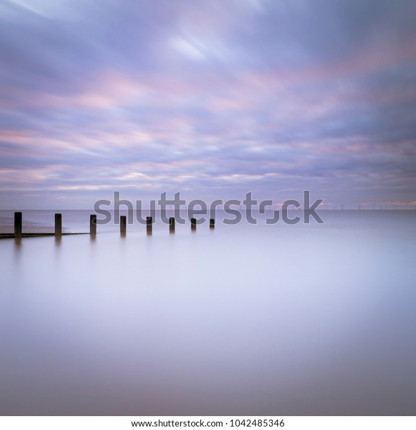 Long exposure on Skegness beach with the wind farm in the background.