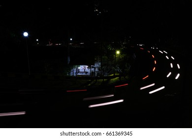 Long Exposure on Windy Road Cars Passing