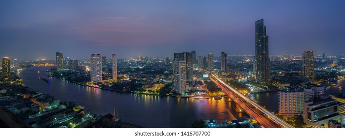 Long exposure panorama cityscape and river view in Bangkok with beautiful night lighting