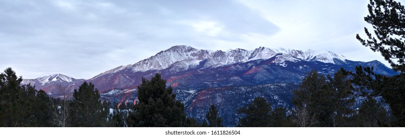 Long exposure panoramic of Pikes Peak in Colorado at first sunlight on an overcast morning.
