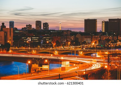 Long exposure of Paris skyline and traffic movement light trails on the peripheral boulevard with eiffel tower in the distance