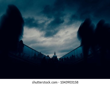 Long exposure of pedestrians at London, England, UK Millenium Bridge with St. Paul's Cathedral in background - dystopia dark post-apocalyptic fine art concept - DELIBERATE UNDEREXPOSURE