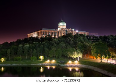 Long exposure at Perdana Putra, Prime Minister's Office of Malaysia, Putrajaya on top of the hill and beside the lake during the night with some smooth reflection, sunstar and bright lamp