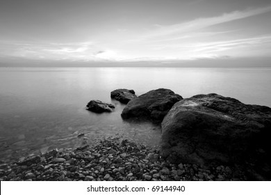 Long exposure photo of beach in the evening, black and white