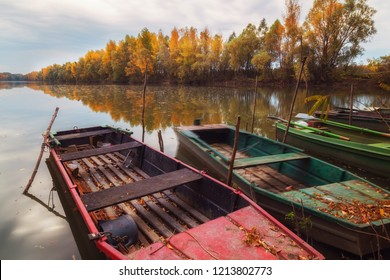 Long exposure photo of fishing boats anchored on the shore of Tisza river