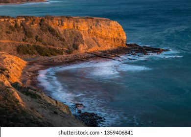 Long exposure photo of Inspiration Point cliff at sunset with waves crashing onto the rocks below Abalone Cove Shoreline Park, Rancho Palos Verdes, California