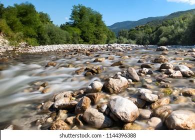 Long exposure photo of Natisone river at Biarzo, a small village close to Cividale del Friuli, Udine province, Friuli Venezia Giulia region, Italy.