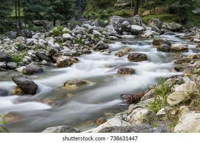 A long exposure photo of a river flowing in hilly region in Kasol, India.