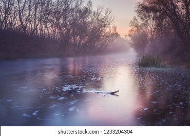 Long exposure photo of river at sunrise