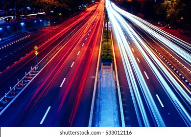Long exposure photo of traffic with blurred traces from cars, top view.