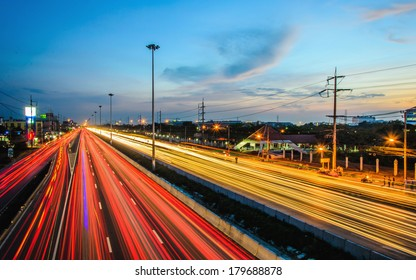 Long exposure photo of traffic on the move at dusk skyline in Bangkok, Thailand