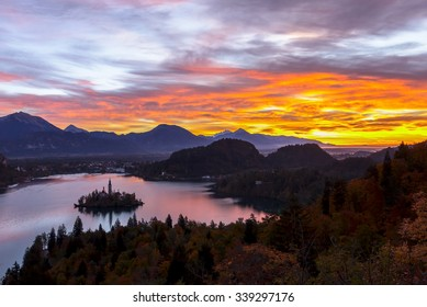 Long exposure photograph of dark landscape of silhouette Bled island and European alps in the very early morning before sunrise with dramatic colorful sky, Bled, Slovenia, Europe