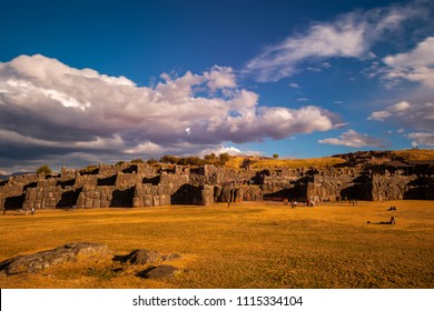 Long exposure photograph of the inca fortress Sacsayhuaman with its massive granite stone blocks and motion blur of tourists near Cusco, Peru, South America.