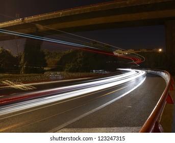 Long exposure photographs of urban night dusk highway traffic