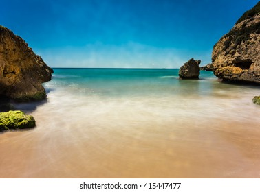 Long exposure photography of cala Tobera creek also known as cala del Castell, Tamarit, Tarragona, Spain