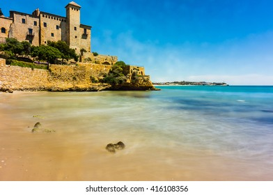 Long exposure photography of cala Tobera creek with Tamarit castle as background, Tarragona, Spain