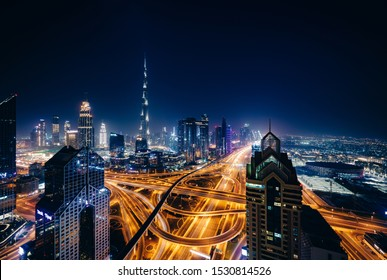 Long exposure photography of Dubai at night from the top of a building.