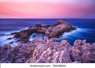 Long exposure photography: North coast of Menorca at sunset, Spain