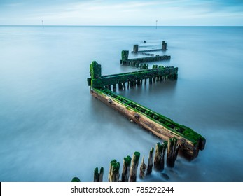 Long exposure photography of wooden sea defences Hunstanton Norfolk England