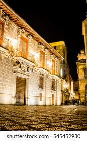 Long exposure picture of a stone street taken at night close to an old palace