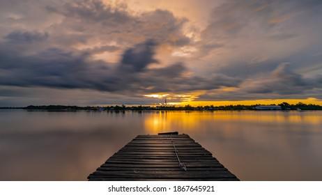 Long exposure of pier overlooking sunset - Shutterstock ID 1867645921