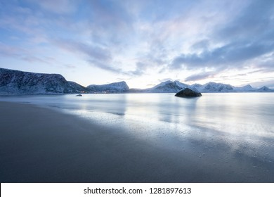 Long exposure polar night landscape of beach with mountain in the winter