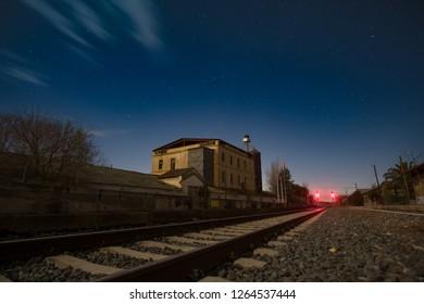 Long exposure railway night scene with starry sky