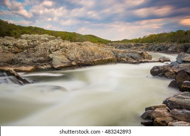 Long exposure of rapids in the Potomac River at sunset, at Great Falls Park, Virginia.