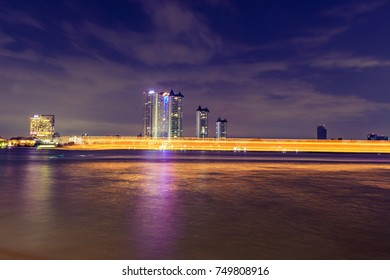 Long exposure river front business towers, Bangkok, Thailand,