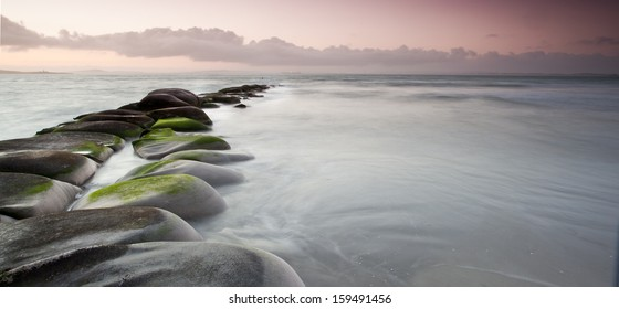 long exposure of rocks and sea