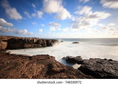 Long exposure from rocks and sea in the Portuguese coastline