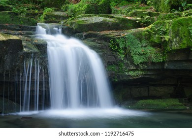 Long exposure of Satinsky waterfall in the forest, Beskydy Mts.