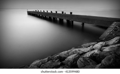 Long exposure of a scottish pier in black and white