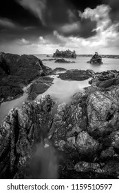 Long exposure seascape and rocky beach in black and white. Nature composition.